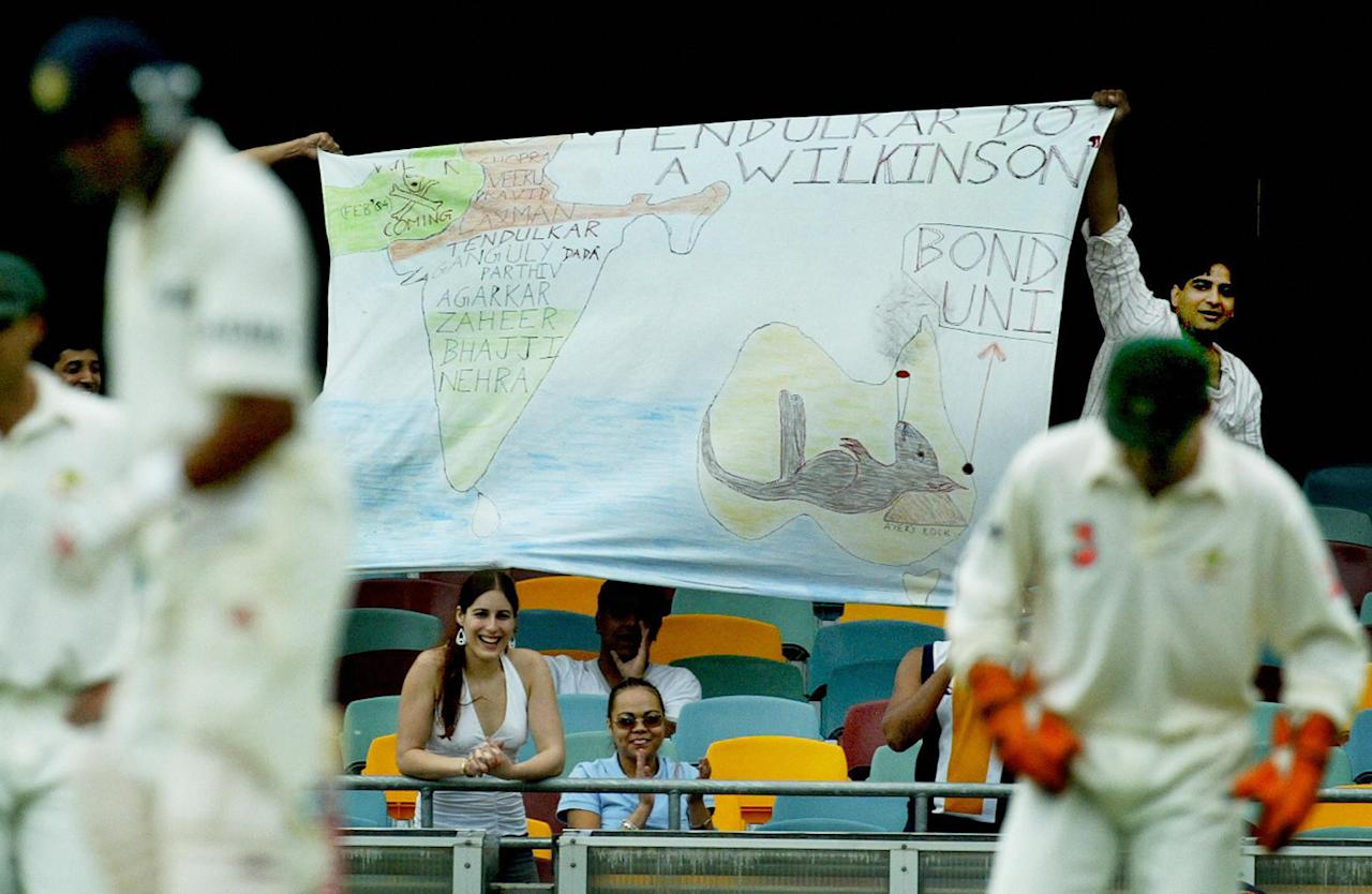 "BRISBANE, AUSTRALIA:  Indian fans hold up a banner saying ""Tendulkar do a Wilkinson"", as players contest a short session on day three of the first cricket Test, at the Gabba cricket ground in Brisbane, 06 December 2003. Australia were all out on 323 in their first innings, with India no wicket for 11 runs in reply.  AFP PHOTO/Greg WOOD  (Photo credit should read GREG WOOD/AFP/Getty Images)"
