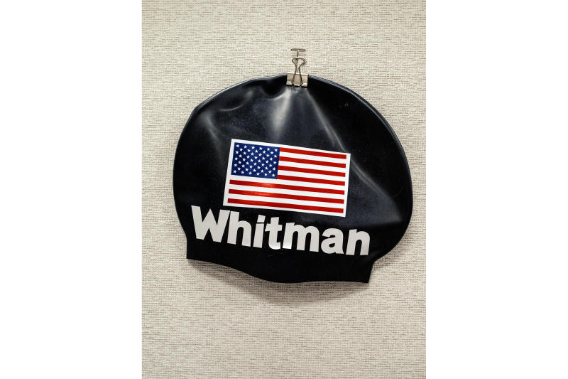 """A swim cap pinned to the wall of Whitman's cubicle. She took up swimming again to reenergize after a failed political run: """"I needed something to take my mind off losing."""""""