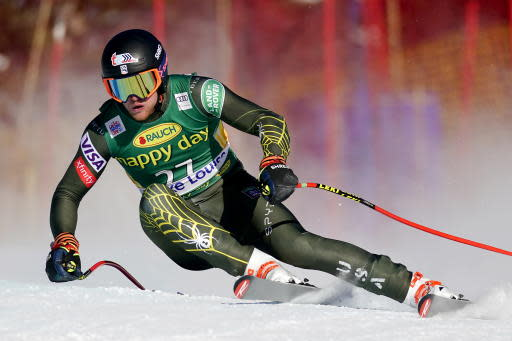 CORRECTS TO SUPER-G NOT DOWNHILL -Ryan Cochran-Siegle, of the United States, moves down the course during the men's World Cup super-G ski race in Lake Louise, Alberta, Sunday, Dec. 1, 2019. (Frank Gunn/The Canadian Press via AP)