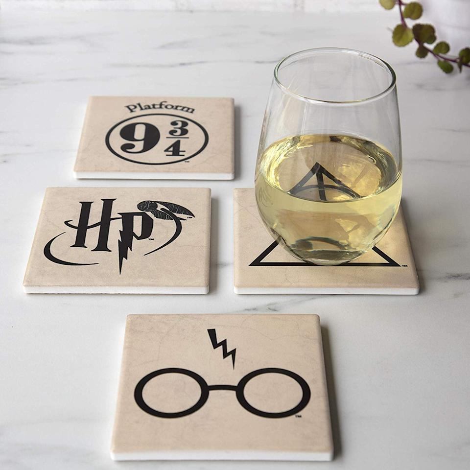 """<p>They can put these <a href=""""https://www.popsugar.com/buy/Harry-Potter-Coasters-497495?p_name=Harry%20Potter%20Coasters&retailer=amazon.com&pid=497495&price=18&evar1=geek%3Aus&evar9=36255652&evar98=https%3A%2F%2Fwww.popsugartech.com%2Fphoto-gallery%2F36255652%2Fimage%2F46710820%2FHarry-Potter-Coasters&list1=holiday%2Cgift%20guide%2Charry%20potter%2Choliday%20living%2Cgeek%20culture&prop13=mobile&pdata=1"""" rel=""""nofollow"""" data-shoppable-link=""""1"""" target=""""_blank"""" class=""""ga-track"""" data-ga-category=""""Related"""" data-ga-label=""""https://www.amazon.com/Harry-Potter-Coasters-Ceramic-Coaster/dp/B07K2HYT3M/ref=sr_1_90?keywords=best+harry+potter+gifts&amp;qid=1570046259&amp;s=gateway&amp;sr=8-90"""" data-ga-action=""""In-Line Links"""">Harry Potter Coasters</a> ($18) on their coffee table.</p>"""