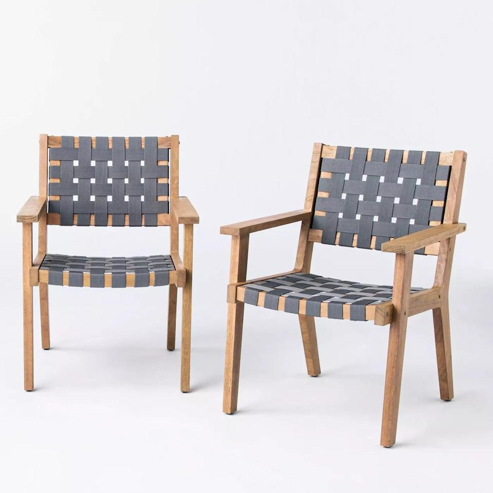 <p>The <span>Wood Strapping Patio Club Chairs</span> ($330) can blend in with any preexisting furniture. </p>