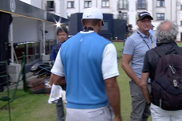 Tiger Woods sparked concern with tape on his neck. (via screenshot)