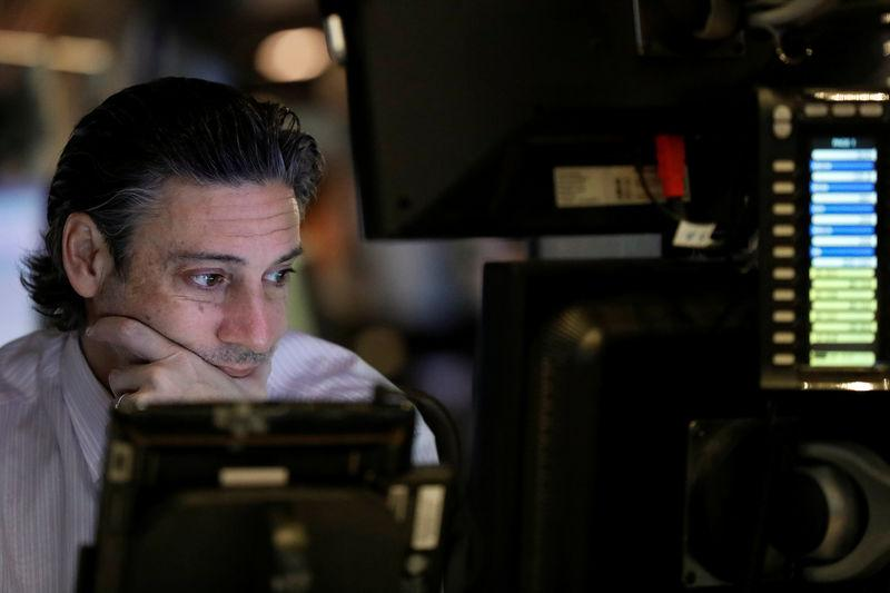 A trader works on the floor of the New York Stock Exchange (NYSE) before the opening bell