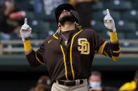 San Diego Padres' Fernando Tatis Jr. celebrates his solo home run during the first inning of a spring training baseball game against the Oakland Athletics, Friday, March 12, 2021, in Mesa, Ariz. (AP Photo/Matt York)