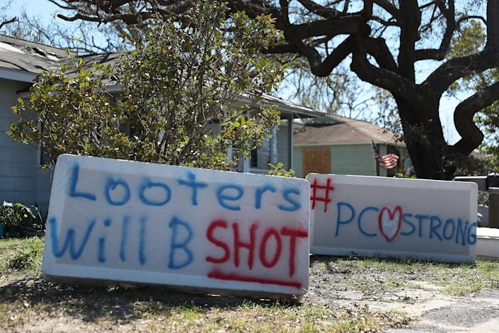 <p>Signs reading, 'Looters Will B Shot' and '#PCStrong,' are seen written on mattress boxes in front of a home as people deal with the aftermath of hurricane Michael on Oct. 13, 2018 in Panama City, Fa. (Photo: Joe Raedle/Getty Images) </p>