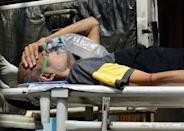 <p>Hospitals, graveyards and crematoriums have become overwhelmed with new cases and deaths.</p> <p>As life-saving oxygen is in short supply, some patients have died in the streets, while searching for a hospital that can take them.</p>