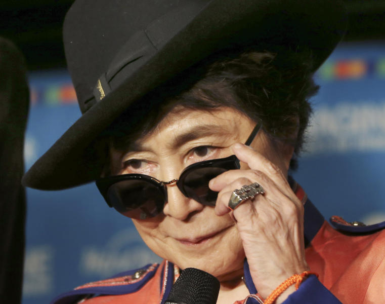 "Yoko Ono adjusts her sunglasses as she speaks during a campaign to fight childhood hunger around the world, in Tokyo Thursday, Dec. 5, 2013. The 80-year-old widow of John Lennon said that she believes he would be happy to see his song ""Imagine"" used by WhyHunger and Hard Rock to raise support for their child nutrition and sustainable farming efforts in 22 countries. (AP Photo/Koji Sasahara)"