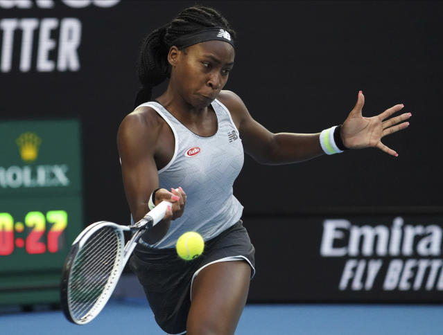 Coco Gauff of the U.S. makes a forehand return to Japan's Naomi Osaka during their third round singles match at the Australian Open tennis championship in Melbourne, Australia, Friday, Jan. 24, 2020. (AP Photo/Lee Jin-man)