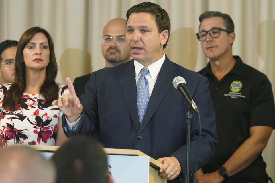 In this Aug. 10, 2021, photo, Florida Gov. Ron DeSantis answers questions related to school openings and the wearing of masks in Surfside, Fla. Top Republicans are battling school districts in their own states' urban, heavily Democratic areas over whether students should be required to mask up as they head back to school. (AP Photo/Marta Lavandier)