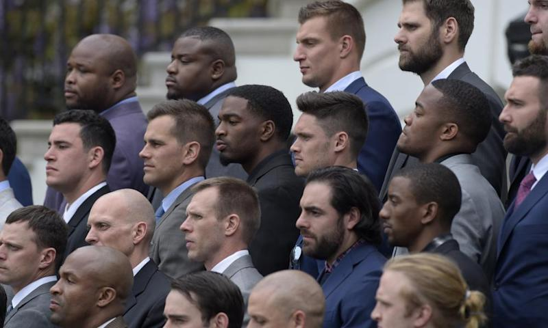 Members of the New England Patriots, including tightend Robert Gronkowski, top center right, listen as Donald Trump speaks during a ceremony on the South Lawn of the White House.