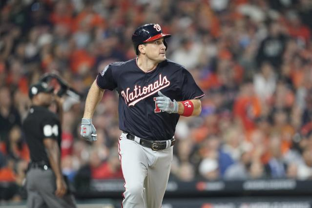 Washington Nationals' Ryan Zimmerman hits a home run during the second inning of Game 1 of the baseball World Series against the Houston Astros Tuesday, Oct. 22, 2019, in Houston. (AP Photo/David J. Phillip)