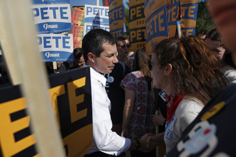 Democratic presidential candidate South Bend Mayor Pete Buttigieg, center, meets with supporters before the Iowa Democratic Wing Ding at the Surf Ballroom, Friday, Aug. 9, 2019, in Clear Lake, Iowa. (AP Photo/John Locher)
