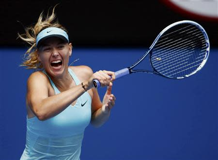 Maria Sharapova of Russia hits a return to Alize Cornet of France during their women's singles match at the Australian Open 2014 tennis tournament in Melbourne January 18, 2014. REUTERS/David Gray