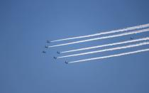 Blue Impulse skywrite Olympic rings in practice run for Games opening ceremony in Tokyo
