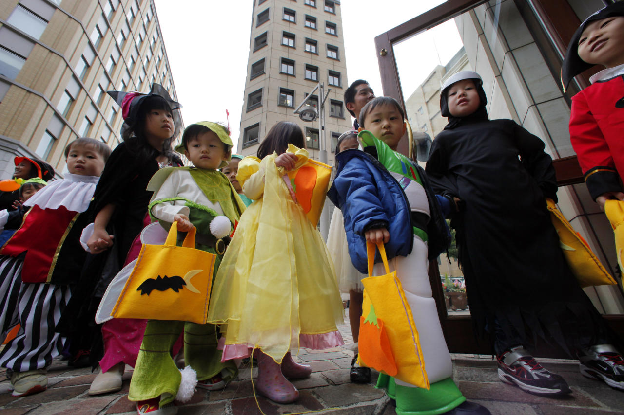 Seven Seas International School children dressed in Halloween costume walk in Tokyo, Japan, as part of their class Friday, Oct. 29, 2010.