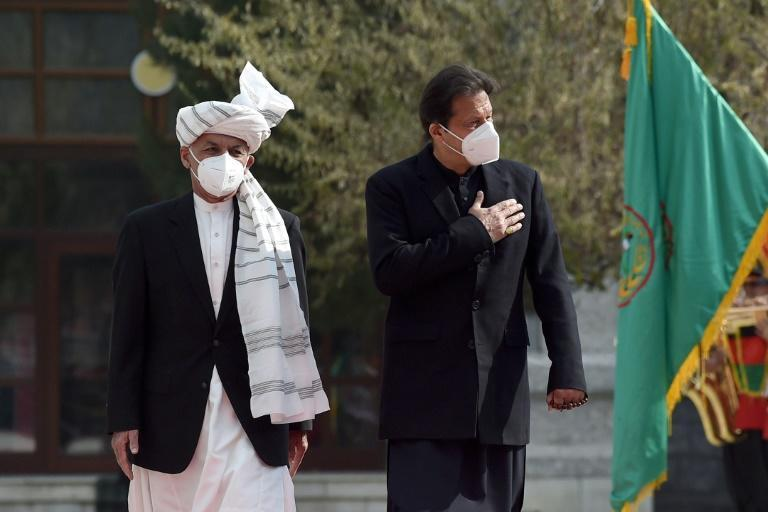 Prime Minister Imran Khan (R, with Afghan President Ashraf Ghani) said Pakistan would do 'whatever is possible' to help reduce violence in Afghanistan