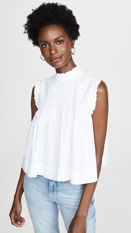 "<p>We love this <a href=""https://www.popsugar.com/buy/Ganni%20Cotton%20Poplin%20Top-471725?p_name=Ganni%20Cotton%20Poplin%20Top&retailer=shopbop.com&price=145&evar1=fab%3Aus&evar9=46414163&evar98=https%3A%2F%2Fwww.popsugar.com%2Ffashion%2Fphoto-gallery%2F46414163%2Fimage%2F46414195%2FGanni-Cotton-Poplin-Top&list1=shopping%2Cblouse%2Ctops%2Csummer%2Ccotton%2Csummer%20fashion&prop13=mobile&pdata=1"" rel=""nofollow"" data-shoppable-link=""1"" target=""_blank"" class=""ga-track"" data-ga-category=""Related"" data-ga-label=""https://www.shopbop.com/cotton-poplin-top-ganni/vp/v=1/1508814571.htm?fm=search-viewall-shopbysize&amp;os=false"" data-ga-action=""In-Line Links"">Ganni Cotton Poplin Top</a> ($145) with white jeans.</p>"