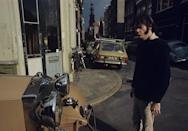 "<p>Musician Neil Young in the street in Amsterdam, Netherlands. </p><p>Other celebrity visitors this year:<span class=""redactor-invisible-space""> David Bowie, Don McLean, Karen Carpenter, Richard Carpenter.<br></span></p>"