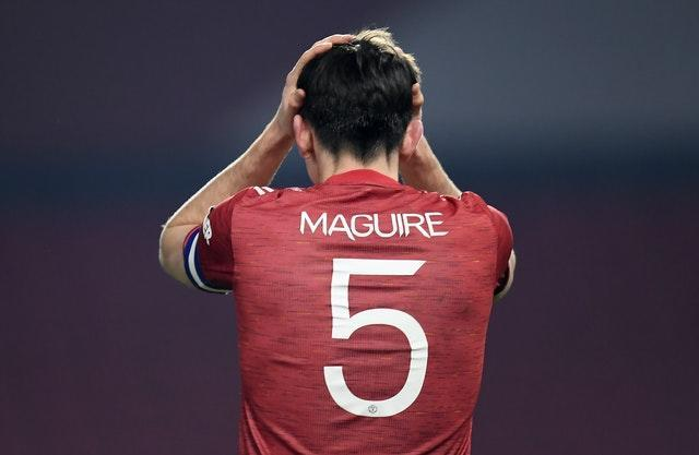 Harry Maguire puts his head in his hands