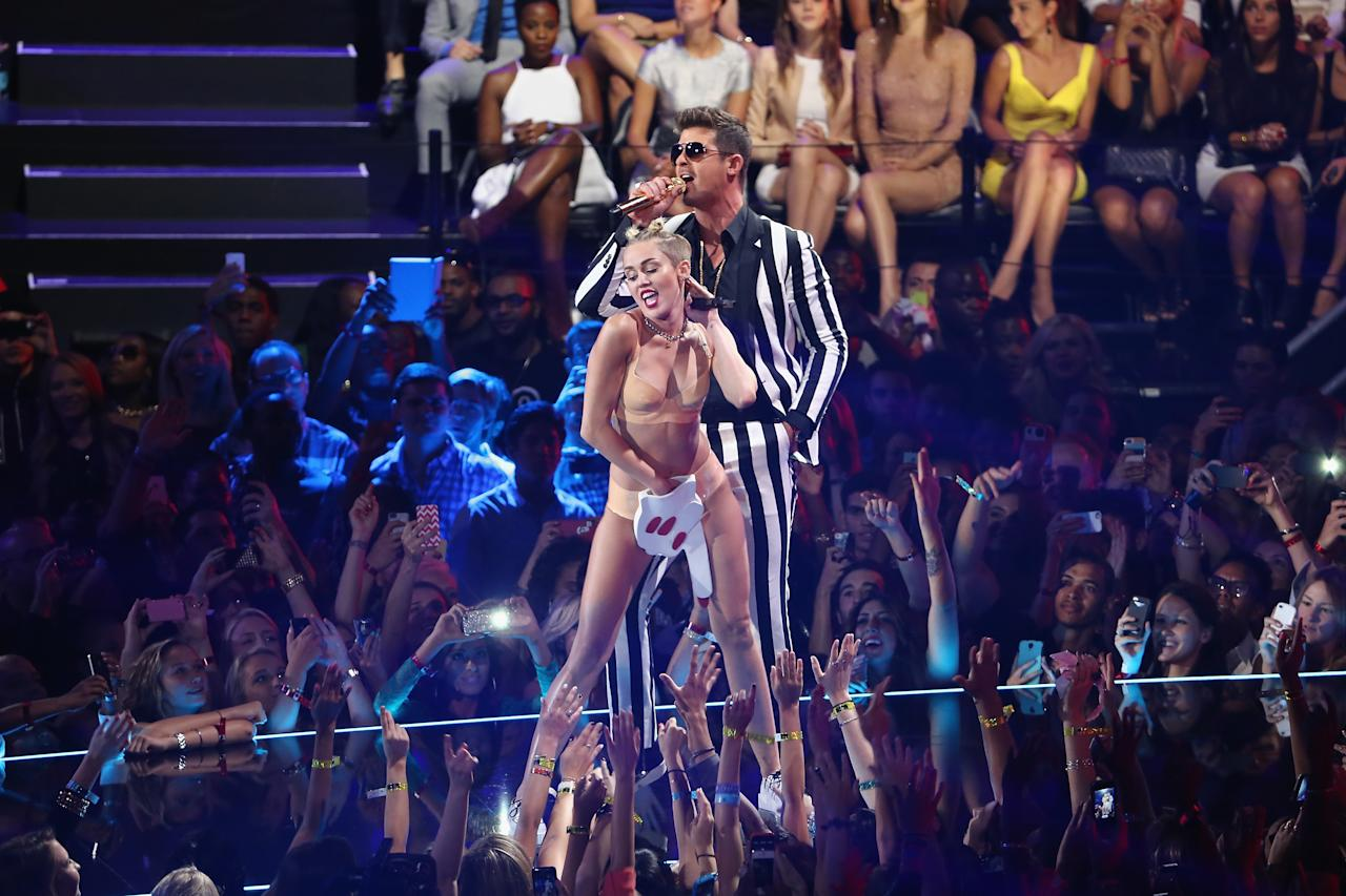 NEW YORK, NY - AUGUST 25:  Miley Cyrus and Robin Thicke performs onstage during the 2013 MTV Video Music Awards at the Barclays Center on August 25, 2013 in the Brooklyn borough of New York City.  (Photo by Neilson Barnard/Getty Images for MTV)