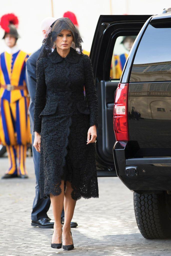 """<p>FLOTUS wore a <a href=""""https://www.townandcountrymag.com/style/fashion-trends/g9923727/pope-dress-code-presidents-royals/"""" rel=""""nofollow noopener"""" target=""""_blank"""" data-ylk=""""slk:very traditional Vatican ensemble"""" class=""""link rapid-noclick-resp"""">very traditional Vatican ensemble</a> to meet with the Pope: a modest black dress and a black lace veil by Italian designer Dolce & Gabbana. </p>"""