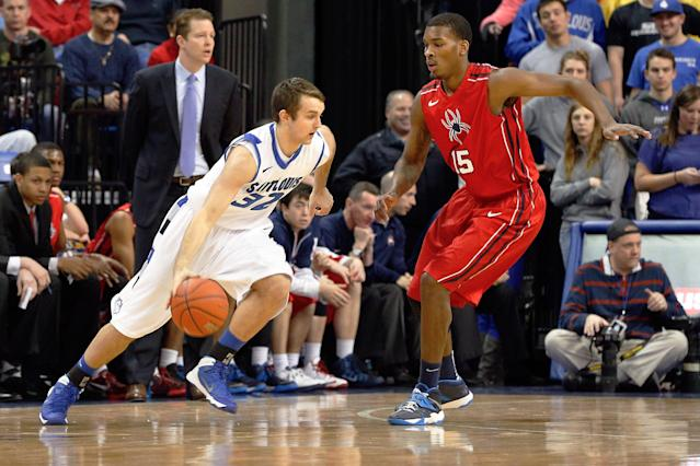Saint Louis' Mike Crawford (32) heads to the basket as Richmond's Terry Allen (15) defends during the first half of an NCAA college basketball game Wednesday, Jan. 29, 2014, in St. Louis. (AP Photo/Scott Kane)