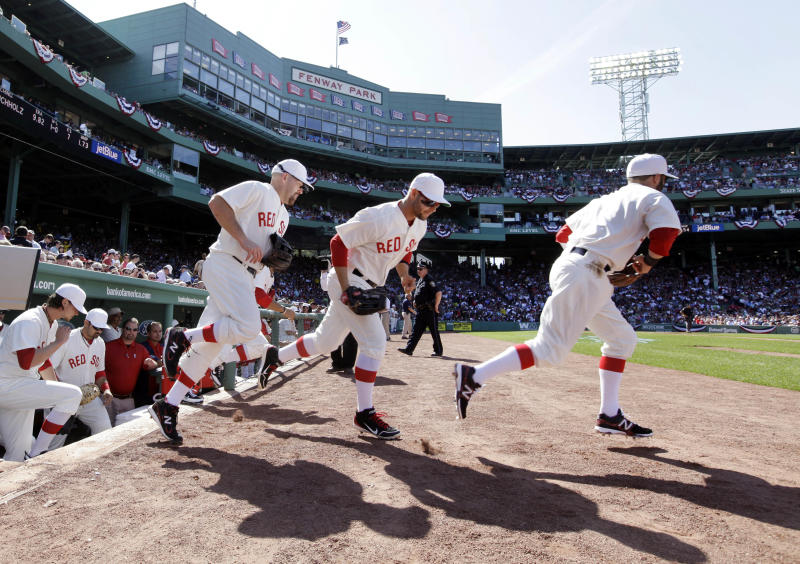 Boston Red Sox players take the field for a baseball game against the New York Yankees in throw-back uniforms of 1912 at Fenway Park in Boston, Friday, April 20, 2012. The Red Sox are celebrating the100th anniversary of the first regular-season game at Fenway Park. (AP Photo/Elise Amendola)