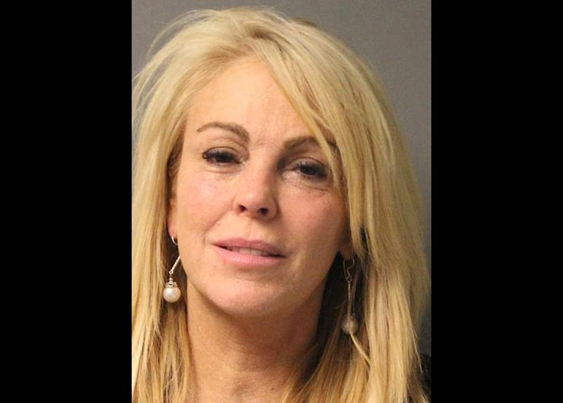 FILE - This file photo provided by the New York State Police in East Farmingdale, N.Y., shows Dina Lohan, mother of Lindsay Lohan, after she was arrested late Thursday, Sept. 12, 2013 on aggravated drunken driving charges. Lohan has a scheduled court appearance Tuesday, Sept. 24, 2013, to answer the charges. (AP Photo/New York State Police, File)