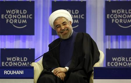 Iran's President Rouhani smiles during session of World Economic Forum in Davos