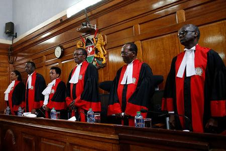 Kenya's Supreme Court judges arrive at the court room before delivering a ruling on cases that seek to nullify the re-election of President Uhuru Kenyatta last month in Kenya's Supreme Court in Nairobi, Kenya November 20, 2017. REUTERS/Baz Ratner