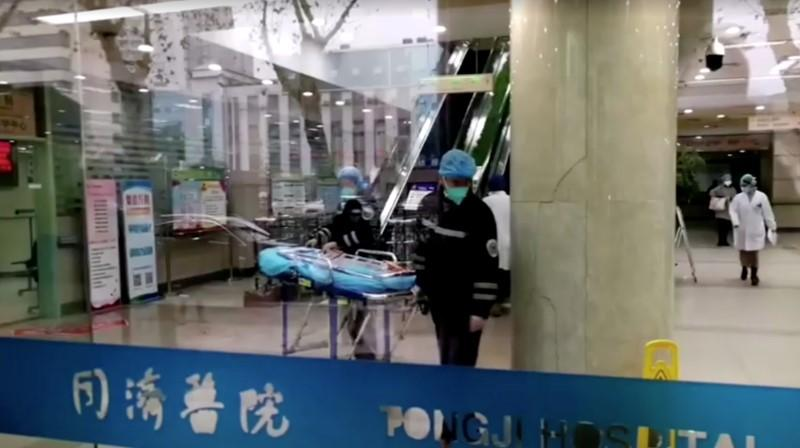 People wearing masks work at a hospital in Wuhan