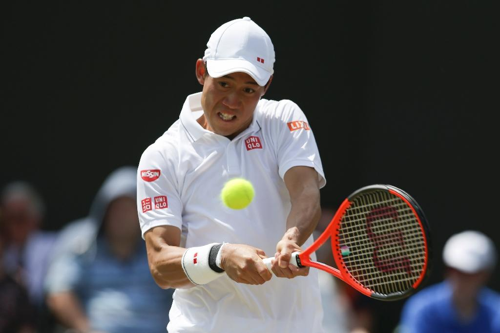 Japan's Kei Nishikori in action at Wimbledon in July 2017 (AFP Photo/Daniel LEAL-OLIVAS)