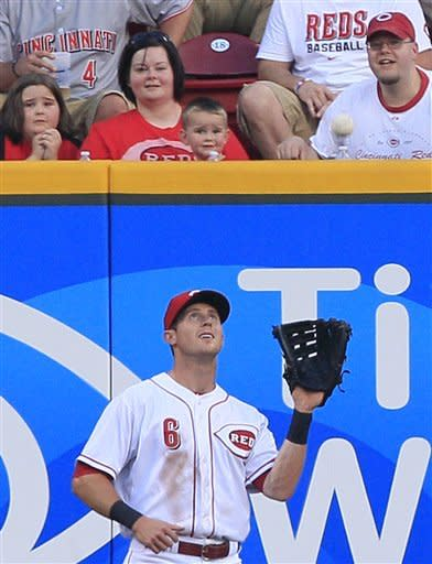 Cincinnati Reds center fielder Drew Stubbs catches a fly ball hit by Atlanta Braves' Tyler Pastornicky in the second inning of a baseball game, Thursday, May 24, 2012, in Cincinnati. (AP Photo/Al Behrman)