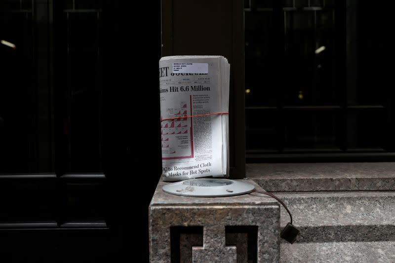 FILE PHOTO: An uncollected Wall Street Journal newspaper on nearly deserted Wall Street during the outbreak of coronavirus disease (COVID-19) in New York