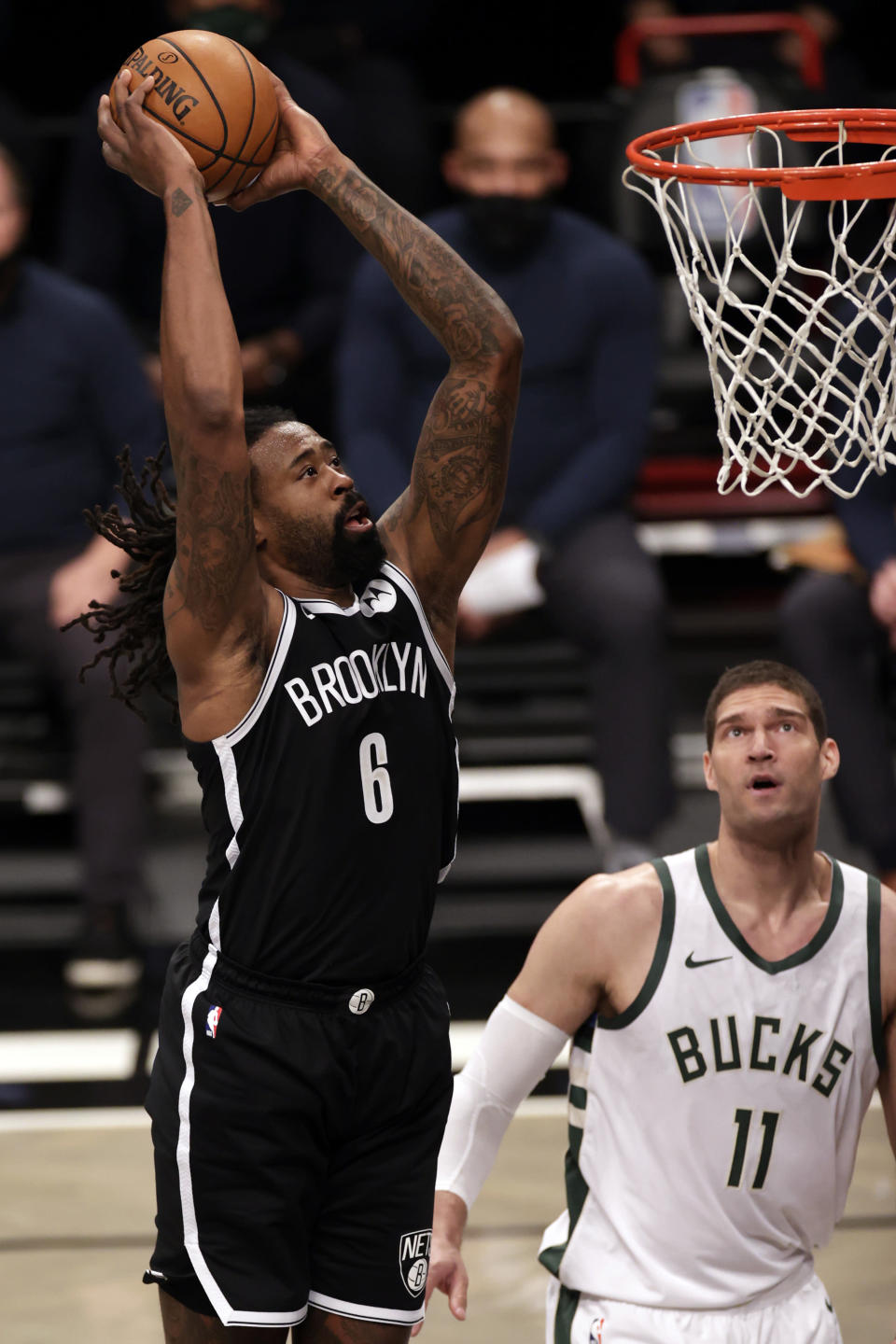 Brooklyn Nets center DeAndre Jordan (6) dunks the ball in front of Milwaukee Bucks center Brook Lopez during the first half of an NBA basketball game Monday, Jan. 18, 2021, in New York. (AP Photo/Adam Hunger)