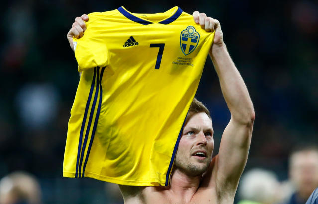 In this image taken on Monday, Nov. 13, 2017 Sweden's Sebastian Larsson celebrates at the end of the World Cup qualifying play-off second leg soccer match between Italy and Sweden, at the Milan San Siro stadium, Italy. (AP Photo/Antonio Calanni)