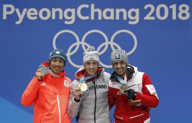 Medals Ceremony - Nordic Combined Events - Pyeongchang 2018 Winter Olympics - Men's Individual 10km - Medals Plaza - Pyeongchang, South Korea - February 15, 2018 - Gold medalist Eric Frenzel of Germany, silver medalist Akito Watabe of Japan and bronze medalist Lukas Klapfer of Austria on the podium. REUTERS/Eric Gaillard