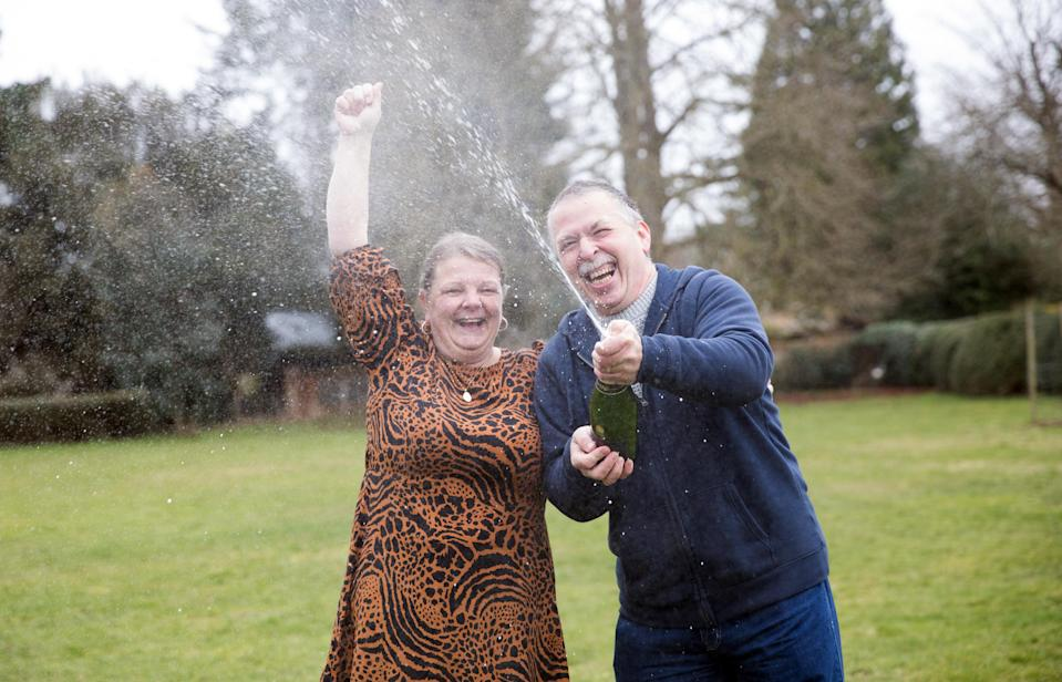 School dinner lady Karen Dakin celebrates with her husband Jeff after winning £1 million on the lottery (National Lottery/ PA)