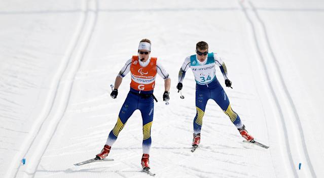 Cross-Country Skiing - Pyeongchang 2018 Winter Paralympics - Men's 20km Free - Visually Impaired - Alpensia Biathlon Centre - Pyeongchang, South Korea - March 12, 2018 - Zebastian Modin of Sweden and his guide compete. REUTERS/Carl Recine