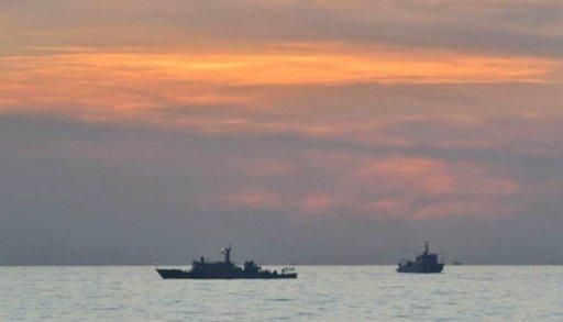 Philippine navy handout, released by the Department of Foreign Affairs, shows Chinese surveillance ships