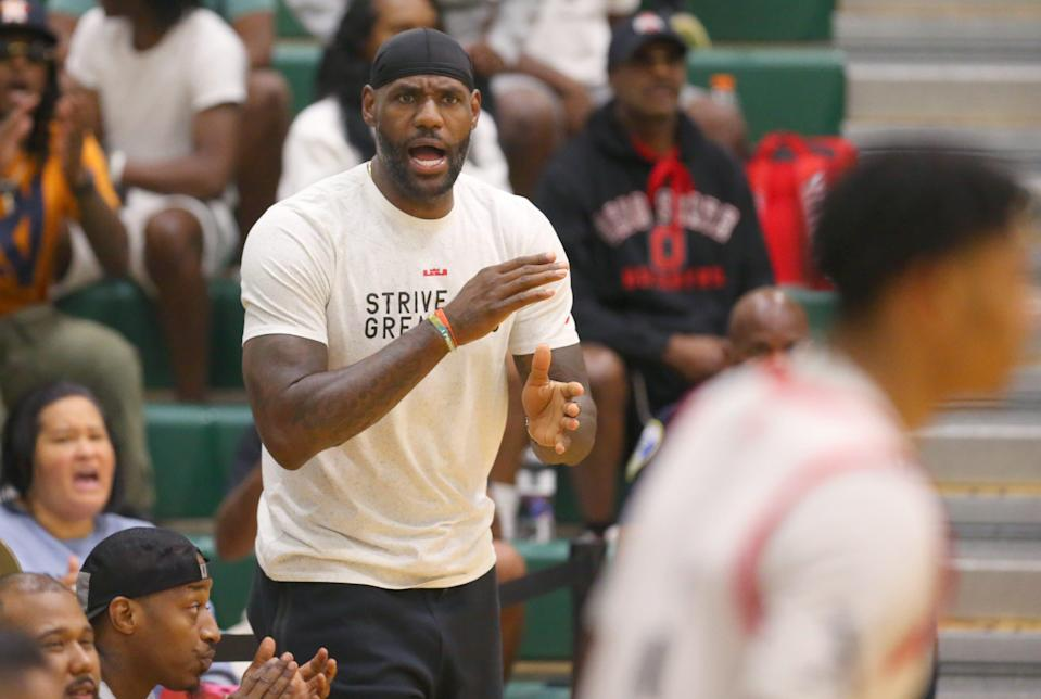 LeBron James cheers on Bronny James and his Strive for Greatness teammates as they take on the Midwest Basketball Club in a AAU game at LeBron James Arena on Friday, July 2, 2021 in Akron, Ohio.  [Phil Masturzo/ Beacon Journal]