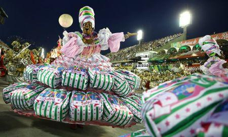 A reveller from Mangueira samba school performs during the second night of the carnival parade at the Sambadrome in Rio de Janeiro