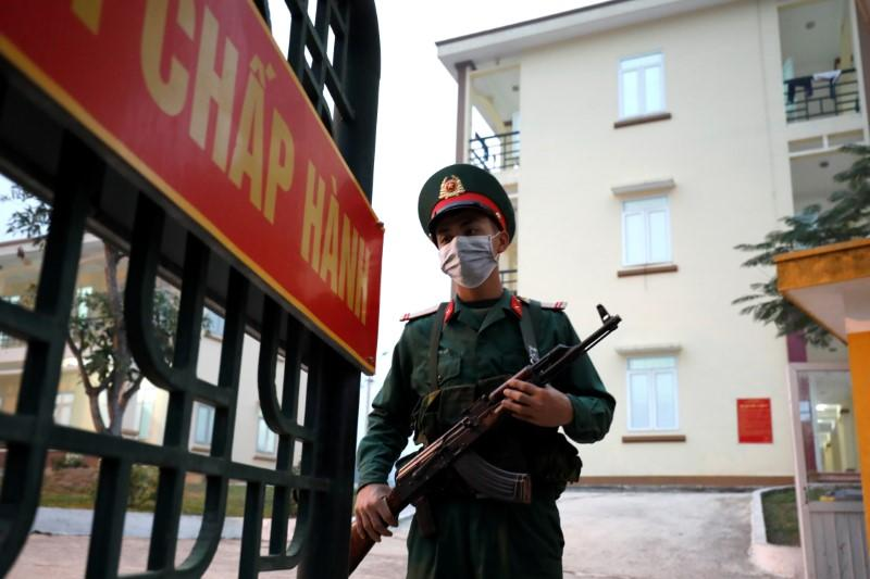 FILE PHOTO: Vietnamese soldier is seen at the gate of a quarantine place at a military base in Lang Son province, Vietnam