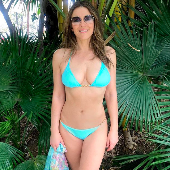 "<p>It's no wonder Elizabeth Hurley wears nothing but a bikini on her Instagram page, as the former supermodel is the proud owner of her own swimwear label. The sea green bikini pictured is currently available to <a href=""https://www.elizabethhurley.com/products/bikinis/antibes-bikini/sea-green/4-926-65"" rel=""nofollow noopener"" target=""_blank"" data-ylk=""slk:shop"" class=""link rapid-noclick-resp"">shop</a>. <em>[Photo: Instagram]</em> </p>"
