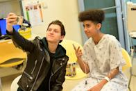<p>Tom Holland visits with children in support of Marvel's The Universe Unites at LAC+USC Medical Center on March 1, 2018 in Los Angeles, California. </p>