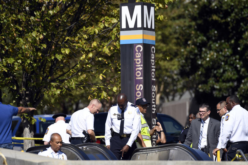 Police gather near the Capitol South Station Metro stop near the U.S. Capitol in Washington, Friday, Oct. 11, 2019. Police say a boy has been stabbed and seriously injured near the Capitol. The Metropolitan Police Department says officers are looking for a 14-year-old girl in connection with the stabbing. (AP Photo/Susan Walsh)