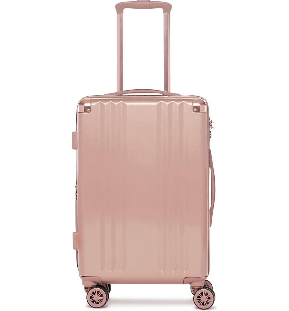 <p>This <span>Calpak Ambeur 22-Inch Rolling Spinner Carry-On</span> ($124, originally $165) is lightweight, easy to travel with, and so pretty! You'll be able to spot your bag from a mile away.</p>