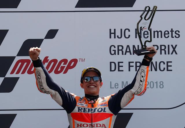 Motorcycling - MotoGP - French Grand Prix - Bugatti Circuit, Le Mans, France - May 20, 2018 Repsol Honda Team's Marc Marquez celebrates with a trophy after winning the race REUTERS/Gonzalo Fuentes