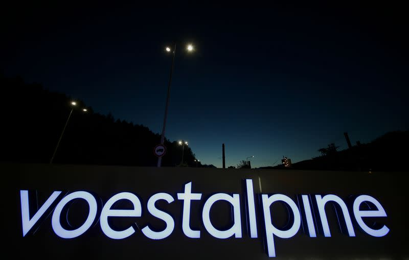 An illuminated logo of steelmaker Voestalpine stands in front of the steel plant Donawitz in Leoben