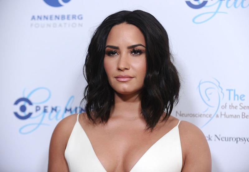 Demi Lovato brings poolside style to the red carpet with this ultra ...